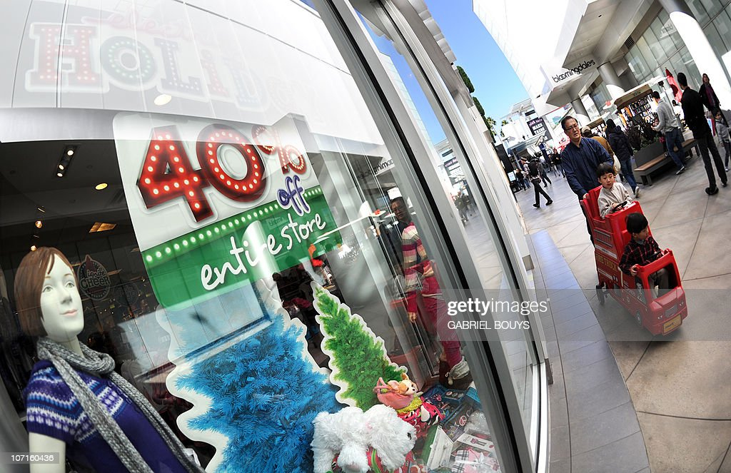 People shop at the Century City shopping mall in Los Angeles California for the day after Thanksgiving 'Black Friday' sales on November 26 2010 Black...