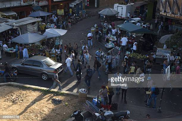People shop for Consumer goods in the Petare neighborhood of Caracas Venezuela on Thursday Nov 12 2015 Plagued by rampant crime unbridled corruption...