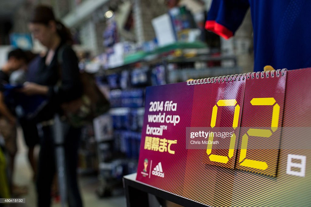 People shop for Japan World Cup team merchandise and FIFA World Cup 2014 merchandise at a football store on June 11, 2014 in Tokyo, Japan. The World Cup 2014 in Brazil will begin on June 12th with the first match between Brazil and Croatia.