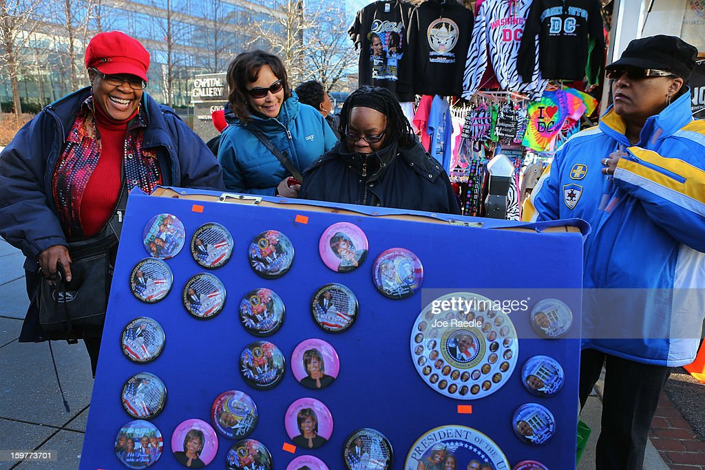 People shop for souvenirs as preparations continue for the Presidential Inauguration on January 20, 2013 in Washington, DC. The U.S. capital is preparing for the second inauguration of U.S. President Barack Obama, which will take place on January 21.