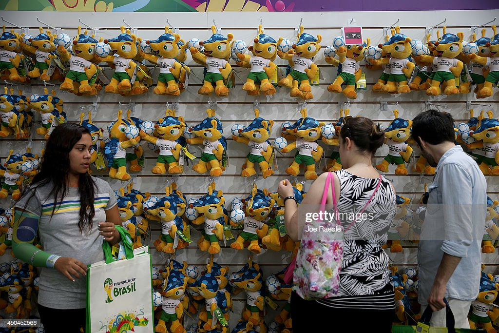 People shop for stuffed toys of the World Cup mascot for sale at the FIFA Fan Fest tent setup on Copacabana beach while waiting for the start of the 2014 FIFA World Cup on June 11, 2014 in Rio de Janeiro, Brazil. Brazil continues to prepare to host the World Cup which starts on June 12th and runs through July 13th.