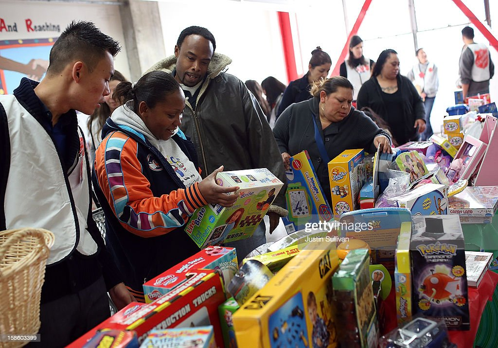 People shop for toys during the Salvation Army's Toy & Joy Shop Distribution on December 20, 2012 in San Francisco, California. With less than one week before Christmas, the Salvation Army's Golden State division held a Toy & Joy Shop Distribution event that allows families in need to shop for free toys and receive a bag with ingredients to make a holiday meal. Nearly 1,500 families will attend the two day event.