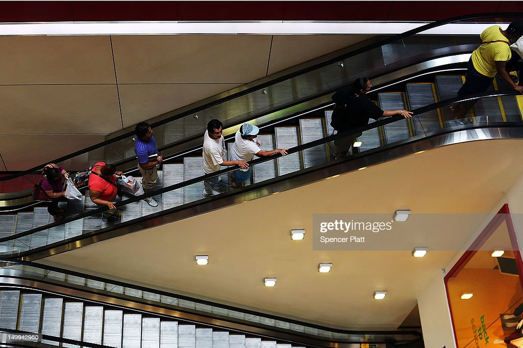 People shop in a mall on August 7, 2012 in New York City. In a further sign that the American economy may be improving the U.S. labor Department said Tuesday that employers posted the most job openings in four years in June. The data comes after FridayÕs news that said employers in July added the most jobs in five months.