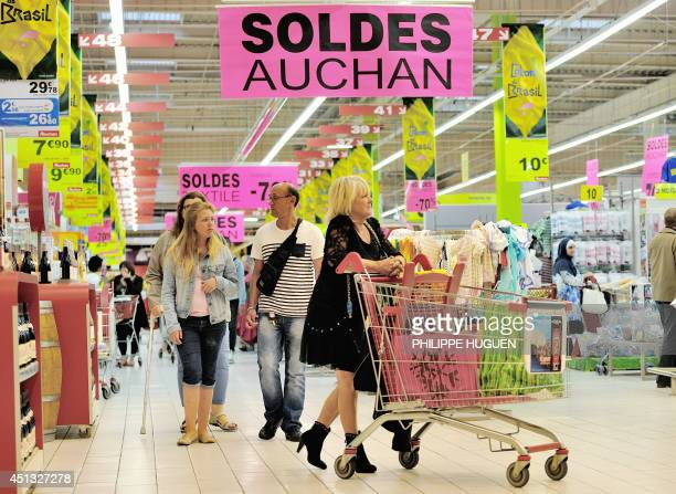 People shop in an Auchan supermarket a branch of the French international retail group Auchan on June 27 in a FachesThumesnil shopping center...