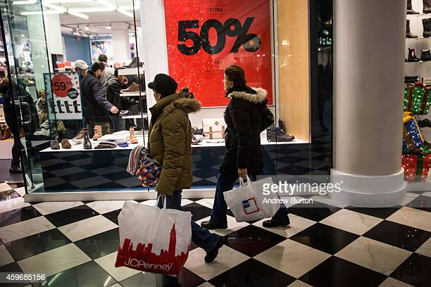 People shop in Manhattan Mall on the morning of November 28 2014 in New York City The Friday after Thanksgiving also known as Black Friday...