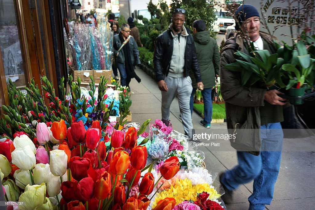 People shop in the floral district on February 13, 2013 in New York City. With Valentines Day tomorrow, the district is experiencing a rush of floral buyers and sellers to service customers on the national day of romance. Along with Mother's Day, Valentine's Day is one of the busiest days of the year for florists and flower growers.