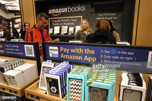 People shop in the newly opened Amazon Books on May 25 2017 in New York City Amazoncom Inc's first New York City bookstore occupies 4000 square feet...