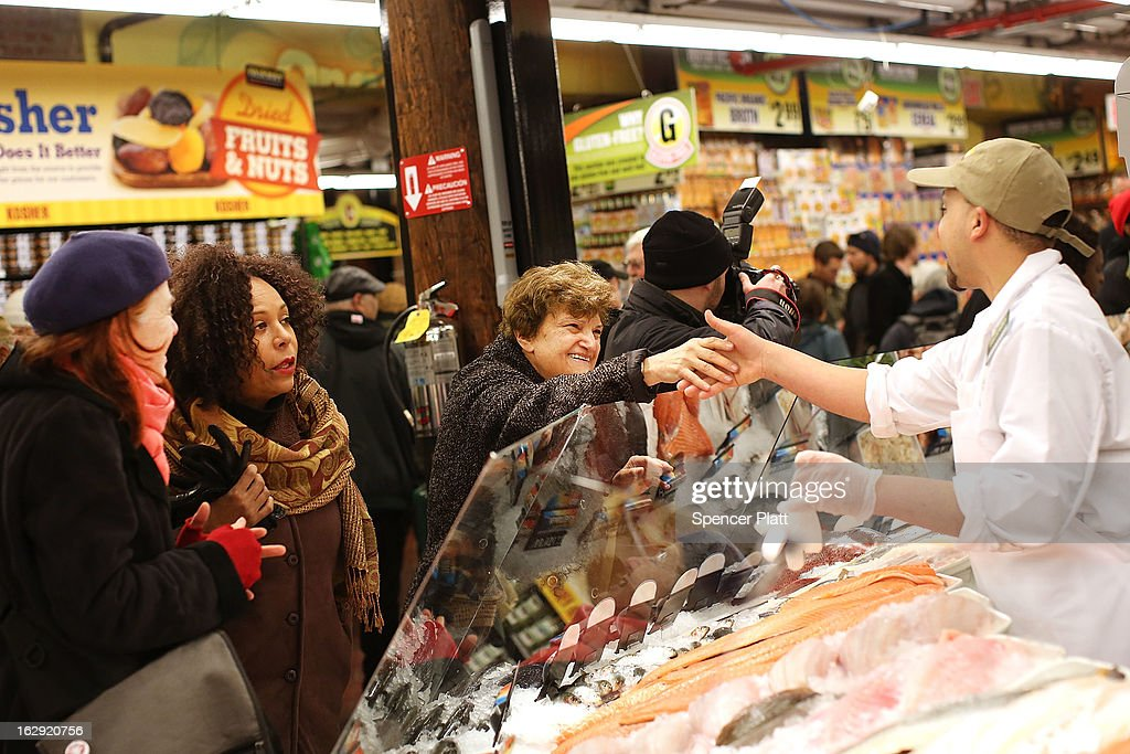 People shop in the newly re-opened Fairway Market on the waterfront in Red Hook on March 1, 2013 in the Brooklyn borough of New York City. Fairway, which quickly became a popular shopping destination and an anchor in the struggling community of Red Hook, was closed following severe flooding during Hurricane Sandy on October 29, 2012. Like the rest of Red Hook, Fairway has struggled to quickly re-open in a neighborhood that lost dozens of businesses during the storm. The re-opening, which included a ceremony and ribbon cutting featuring Miss America and Mayor Michael Bloomberg, is being viewed as Red Hooks official comeback since the storm.
