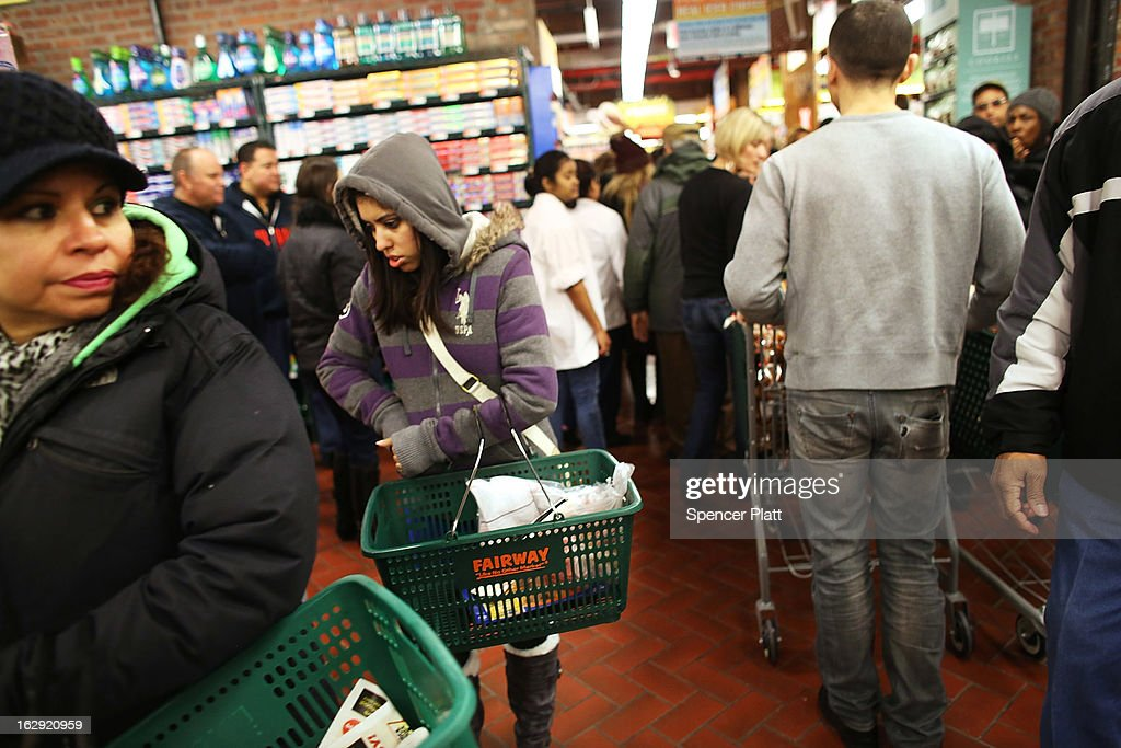 People shop in the newly re-opened Fairway Market on the waterfront in Red Hook on March 1, 2013 in the Brooklyn borough of New York City. Fairway, which quickly became a popular shopping destination and an anchor in the struggling community of Red Hook, was closed following severe flooding during Hurricane Sandy on October 29, 2012. Like the rest of Red Hook, Fairway has struggled to quickly re-open in a neighborhood that lost dozens of businesses during the storm. The re-opening, which included a ceremony and ribbon cutting featuring Miss America and Mayor Michael Bloomberg, is being trumpeted as the Red Hook neighborhood's official comeback since the storm.