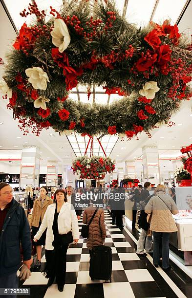 People shop inside Bloomingdale's department store November 26 2004 in New York City The Friday after Thanksgiving called 'Black Friday' is one of...