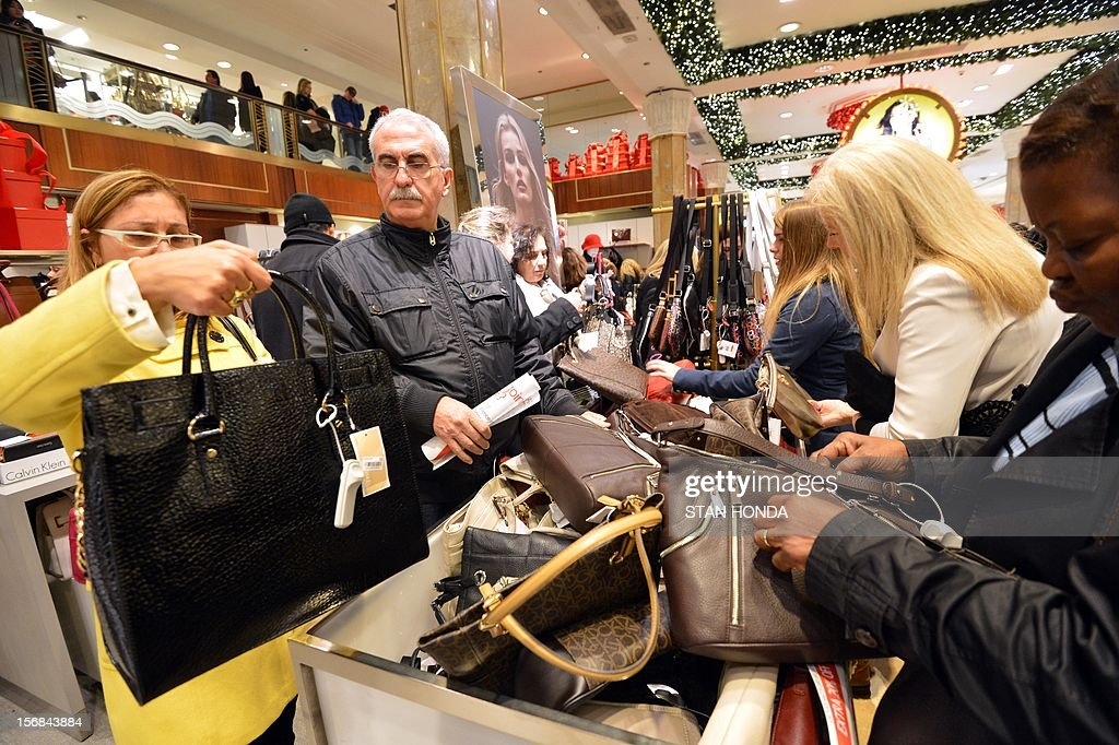 People shop on the first floor of Macy's department store as they open at midnight (0500 GMT) on November 23, 2012 in New York to start the stores' 'Black Friday' shopping weekend. AFP PHOTO/Stan HONDA