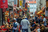 People shopping and eating in Chinatown - Singapore
