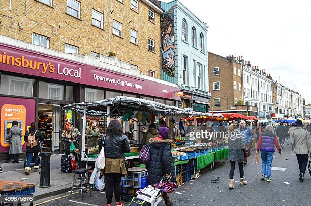 People shopping at Portobello Road Market - London, UK
