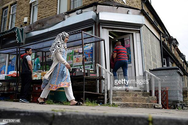 People shopping at the local store in Carrington Street in Bradford on June 16 2015 in Bradford England Three sisters from Bradford are feared to...
