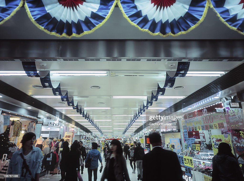 People shopping at underground arcade in Seoul : Stock Photo