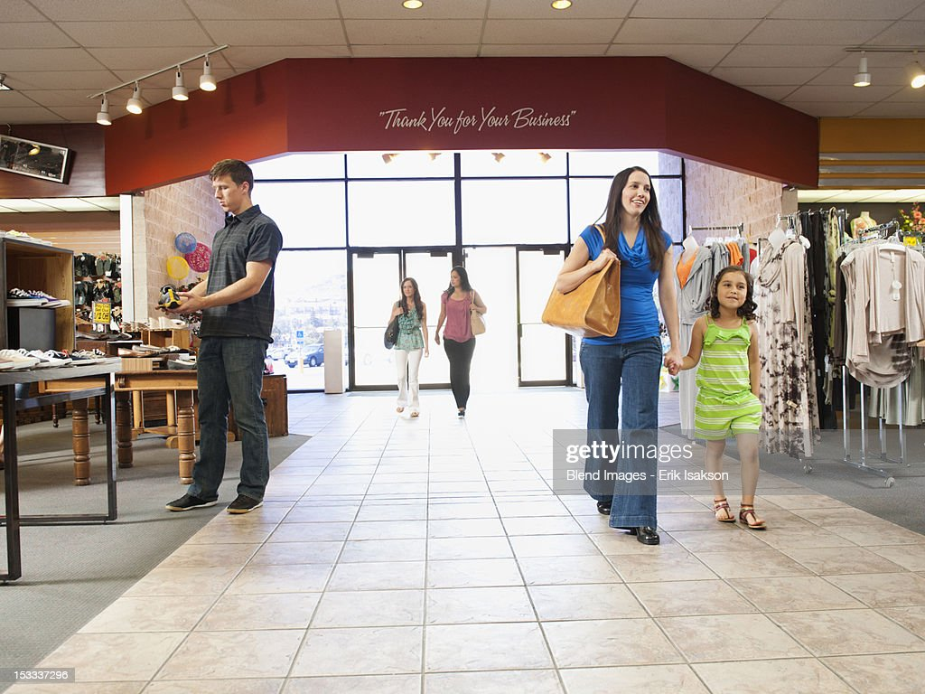 People shopping in clothing store : Stock Photo