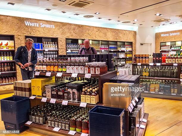 People shopping in Duty Free shops at Oslo Airport, Norway