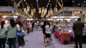 people shopping in exhibiton trade fair - blur for use as background