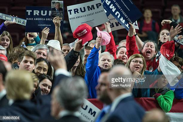 People shout for the attention of Republican presidential candidate Donald Trump at a campaign rally February 5 2016 in Florence South Carolina...