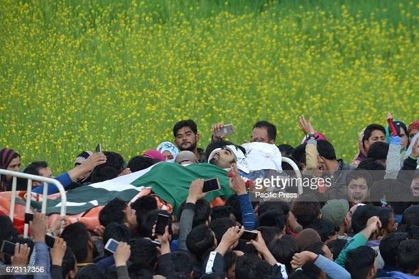 People shout pro freedom slogans as they carry the dead body of Younis Maqbool a rebel of Lashkaretoiba outfit in Patrigam area of Chadoora some 35...