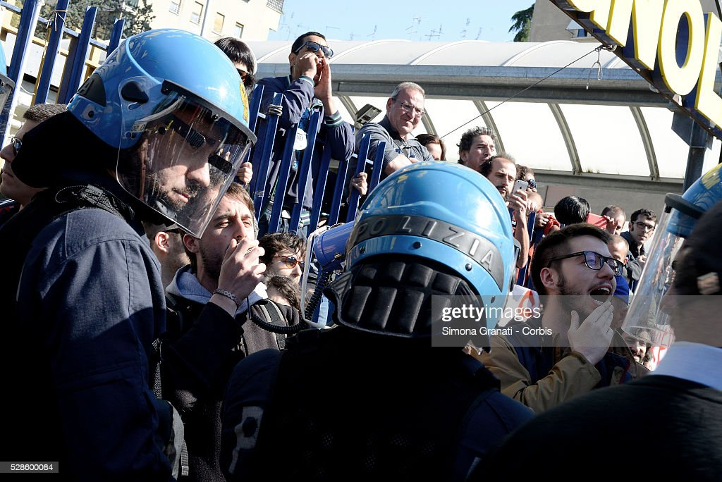 People shout protests as Matteo Salvini, leader of the Northern League party makes a visit to Montagnola market in the southern district of the city on May 4, 2016 in Rome, Italy. Salvini abandoned his visit in the face of anti-racist protests.