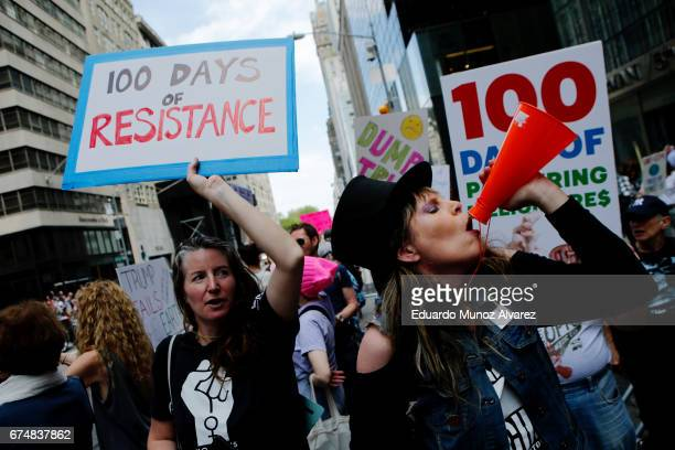 People shout slogans against US President Donald Trump at Trump Tower on April 29 2017 in New York City Activists are protesting against Trump on his...