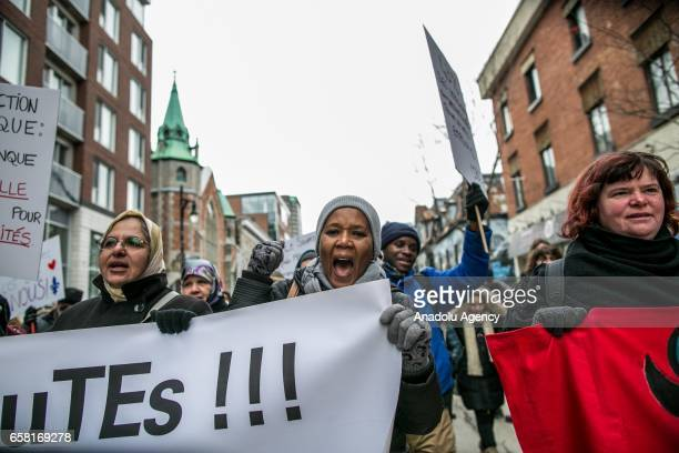 People shout slogans as they carry banners during a march against racism and Islamophobia in Montreal Canada on March 26 2017 The Canadian house of...