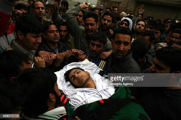 People shout slogans as they carry the body of one of the two civillians killed by Indian soldiers during a funeral procession in Nowgam on the...