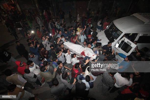 People shout slogans as they carry the body of Sajad Hussain Sheikh who was reportedly killed by government forces in Batmaloo However the Srinagar...