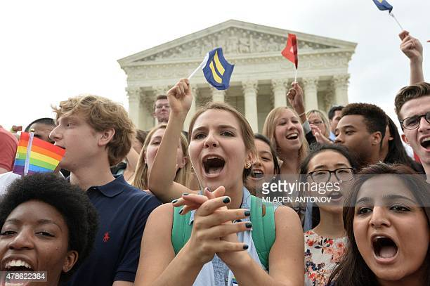 People shout slogans as they celebrate outside the Supreme Court in Washington DC on June 26 2015 after its historic decision on gay marriage The US...