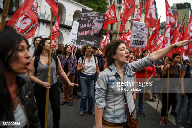 People shout slogans during a demonstratation at the Plaza de Mayo square in Buenos Aires on October 18 a day after the discovery of a body thought...