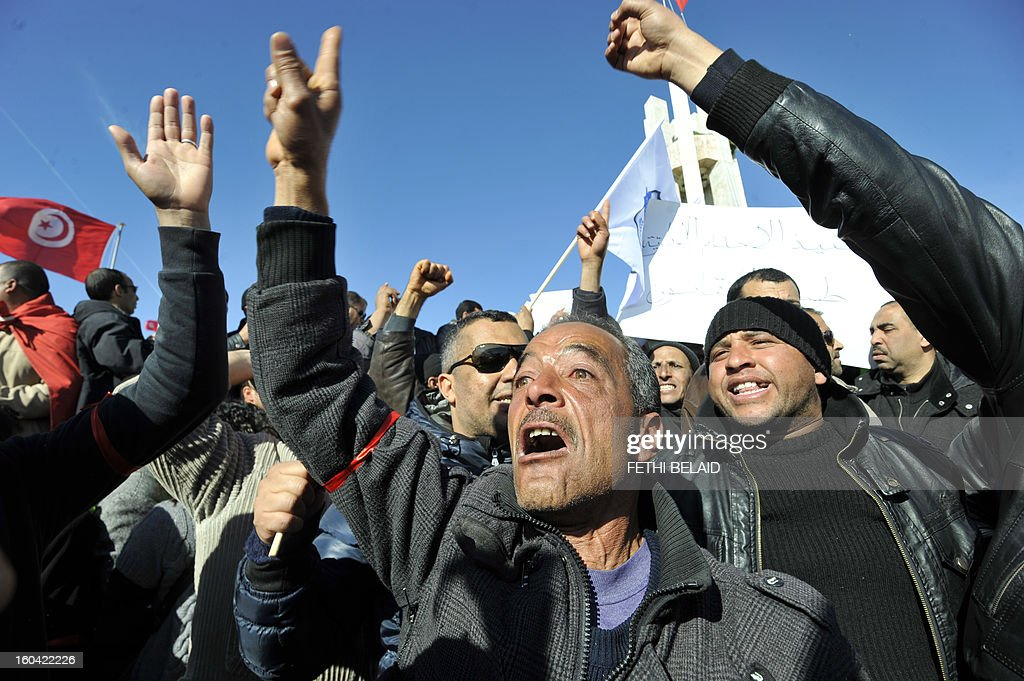 People shout slogans during a demonstration of Tunisian policemen to protest against any kind of political instrumentalization on January 31, 2013 on the Kasbah square, in Tunis.