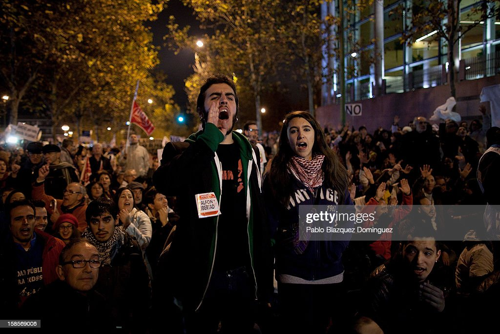 People shout slogans during a health care workers demonstration outside Madrid Regional Asembly on December 19, 2012 in Madrid, Spain. All health workers unions are calling for a third 48 hour strike starting today, against cuts on public health care and the privatization of medical centers and hospitals.