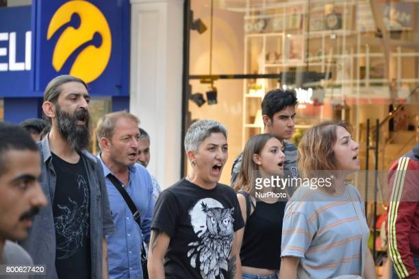 People shout slogans during a march in support of sacked academic Nuriye Gulmen and primary school teacher Semih Ozakca in Ankara Turkey on June 24...