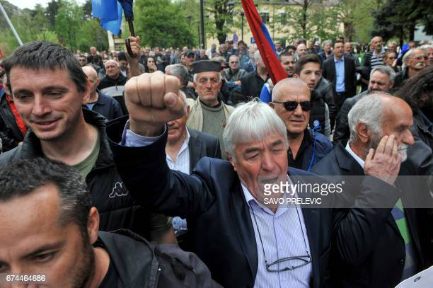 People shout slogans during a protest against the Montenegro's accession to NATO in Cetinje on April 28 2017 Montenegro's parliament formally...