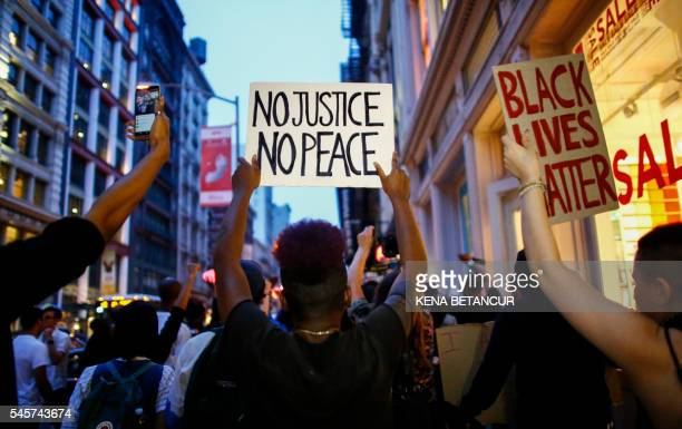 People shout slogans during a protest in support of the Black lives matter movement in New York on July 09 2016 The gunman behind a sniperstyle...