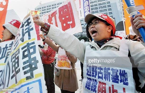 People shout slogans during a rally denouncing the relocation of a US military base in front of the Okinawa prefectural office in Naha southern Japan...