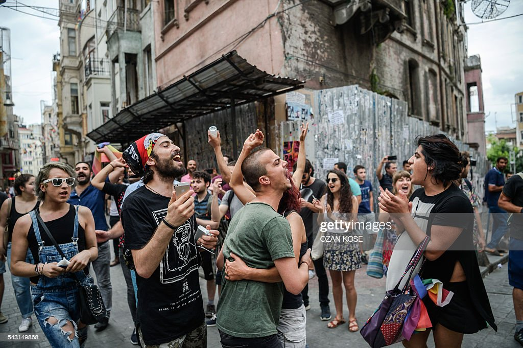 People shout slogans during a rally staged by the LGBT community on Istiklal avenue in Istanbul on June 26, 2016. Riot police fired tear gas and rubber bullets to disperse protesters defying a ban on the city's Gay Pride parade. Authorities in Turkey's biggest city had banned the annual parade earlier this month citing security reasons, sparking anger from gay rights activists. KOSE