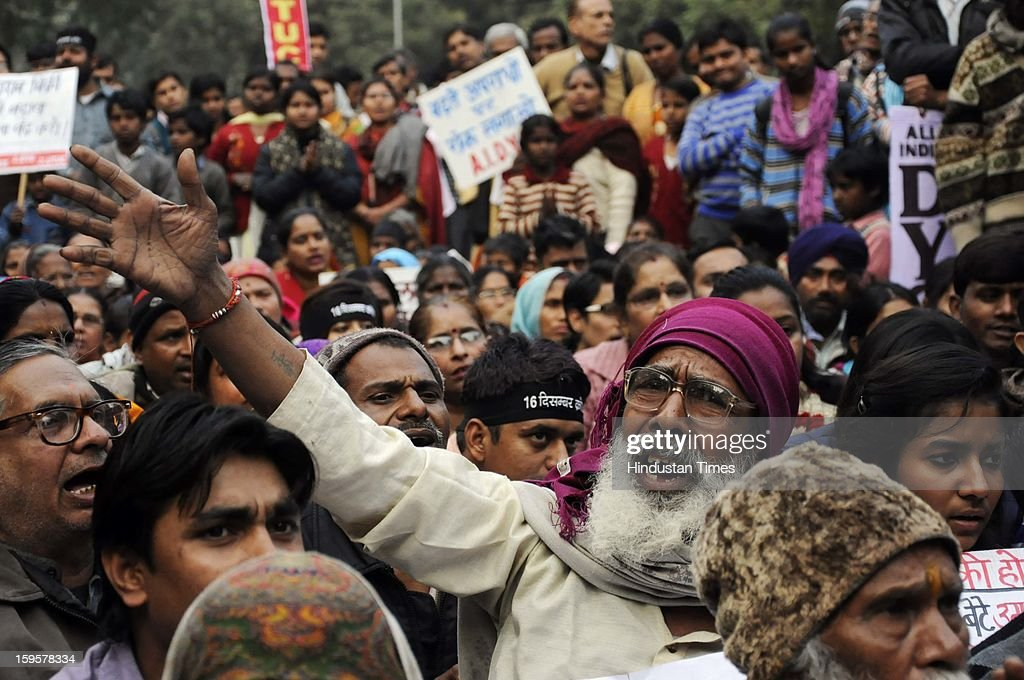 People shout slogans during the protest against the alleged inaction by the Indian government regarding the gang rape of a 23-years old student in a bus a month ago, on January 16, 2013 in New Delhi, India. The bus rape has drawn protests and intense media attention. Rapes have become front-page news nearly every day across the country, with demands that police do more to protect women and that the courts treat sexual violence seriously.