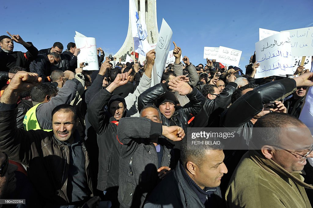 People shout slogans holding placards during a demonstration of Tunisian policemen to protest against any kind of political instrumentalization on January 31, 2013 on the Kasbah square, in Tunis. AFP PHOTO / FETHI BELAID