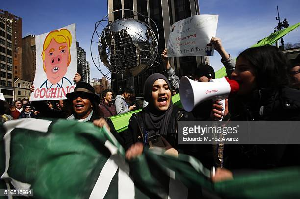 People shout slogans while they take part in a protest against Republican presidential candidate Donald Trump on March 19 2016 in New York City...
