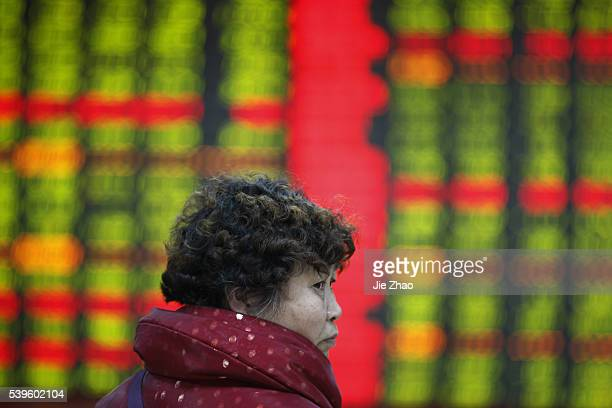 People show different facial expressions when they watch the electric monitor at a stock exchange in Huaibei March 12th 2015 China's main stock...