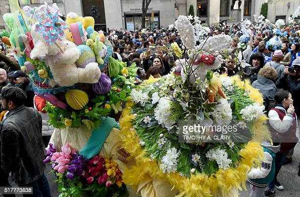 People show off their Easter finery as they walk down Fifth Avenue in New York during the annual Easter Parade and Easter Bonnet Festival March 27...