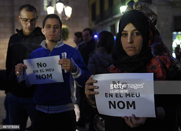 People show posters reading 'Not in my name' during a demonstration called by the IBN Battuta Foundation on behalf of the Muslim community on Plaza...
