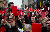 People show red cards as they protest against President of Czech Republic Milos Zeman near a memorial to students who were attacked by riot police in...