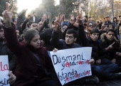 People show the Vsign during an unauthorized protest in support of Karabakh war veteran Zaur Hasanov who immolated himself on December 25 near the...