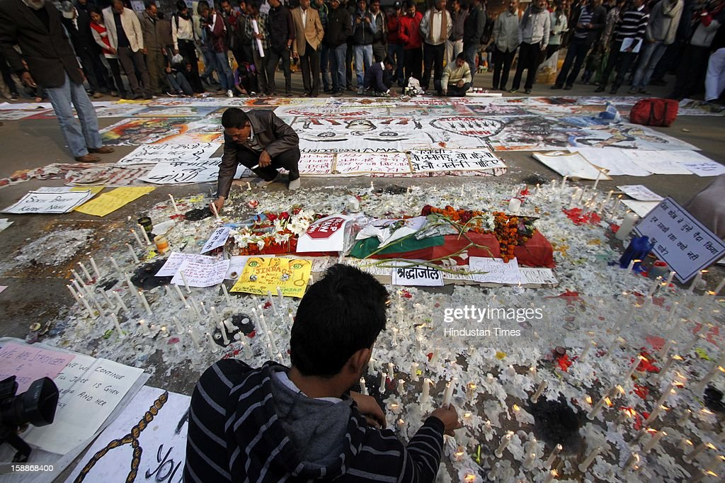 People show their anger and support through series of paintings and slogans on large canvas during protest at Jantar Mantar for girl who died of injuries after brutally gang raped in a moving bus on January 1, 2013 in New Delhi, India. The young woman was cremated promptly on Sunday amid an outpouring of anger and grief by millions across the country demanding greater protection for women from sexual violence.