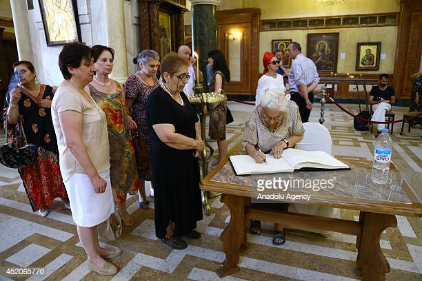 People sign a guest book as they pay respects to the former President of Georgia Eduard Shevardnadze at Holy Trinity Cathedral during a ceremony in...