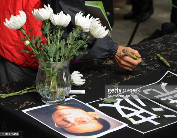 People sign a petition supporting jailed Nobel peace prize laureate Liu Xiaobo in Hong Kong on December 10 2009 China clamped down on dissidents the...