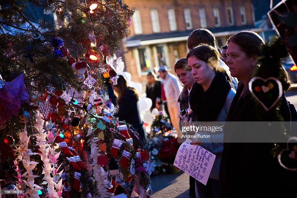 People silently observe a memorial for those killed in the school shooting at Sandy Hook Elementary School on December 24, 2012 in Newtown, Connecticut. Donations and letters are pouring in from across the country as the town tries to recover from the massacre.